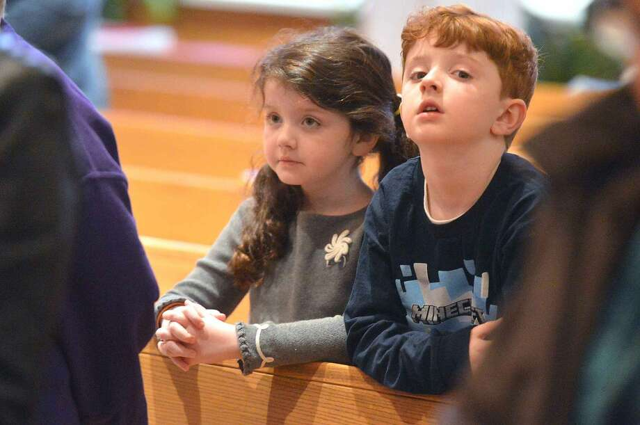Hour Photo/Alex von Kleydorff Good Friday services incuding the Veneration of the Cross and the reading of The Passion at St Jerome Roman Catholic Church on Friday