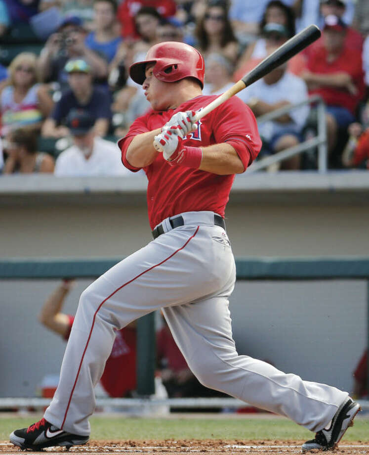 Los Angeles Angels' Mike Trout hits for a base hit against the Chicago Cubs during the first inning of a spring training baseball game, Tuesday, March 25, 2014, in Mesa, Ariz. (AP Photo/Matt York)