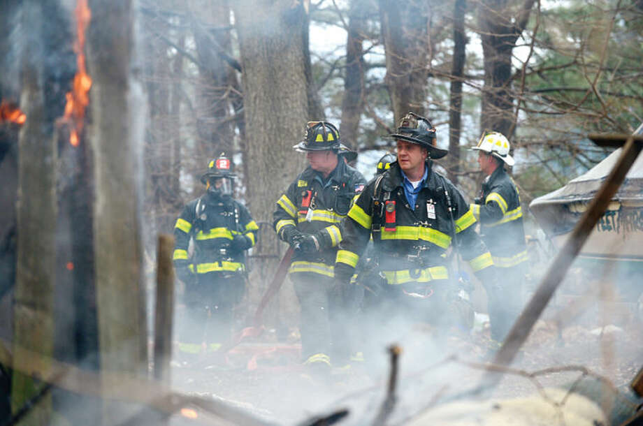 Hour photo / Erik Trautmann Norwalk firefighters respond to 44 Fox Run Rd in Norwalk where a barn was destroyed by fire Saturday afternoon.