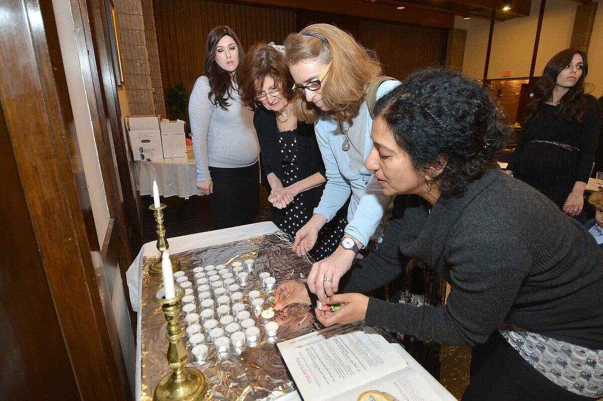 Hour Photo/Alex von Kleydorff Members of Beth Israel on King Street in Norwalk gathered for a Seder on Friday evening to mark the beginning of Passover.