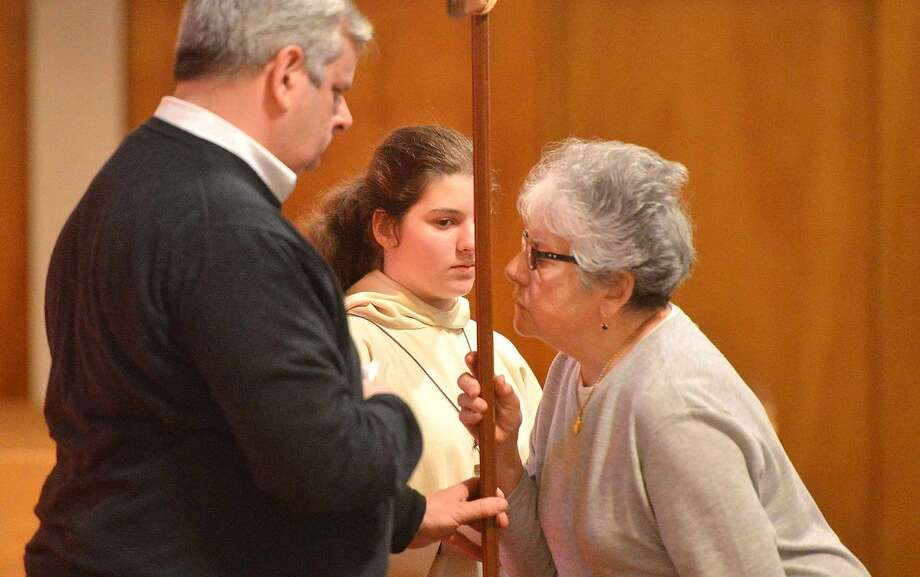 Hour Photo/Alex von Kleydorff Adoration of the cross during Good Friday services incuding the Veneration of the Cross and the reading of The Passion at St Jerome Roman Catholic Church on Friday
