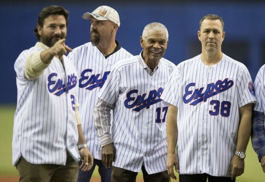 Former Montreal Expos, from left, Darren Fletcher, Larry Walker, manager Felipe alou and Denis Boucher line up as members of the 1994 team are introduced prior to an exhibition baseball game between the Toronto Blue Jays and the New York Mets Saturday, March 29, 2014, in Montreal. (AP Photo/The Canadian Press, Paul Chiasson)
