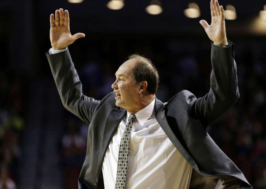 BYU coach Jeff Judkins throws his hands up during the first half of a regional semifinal against Connecticut in the NCAA college basketball tournament in Lincoln, Neb., Saturday, March 29, 2014. (AP Photo/Nati Harnik)