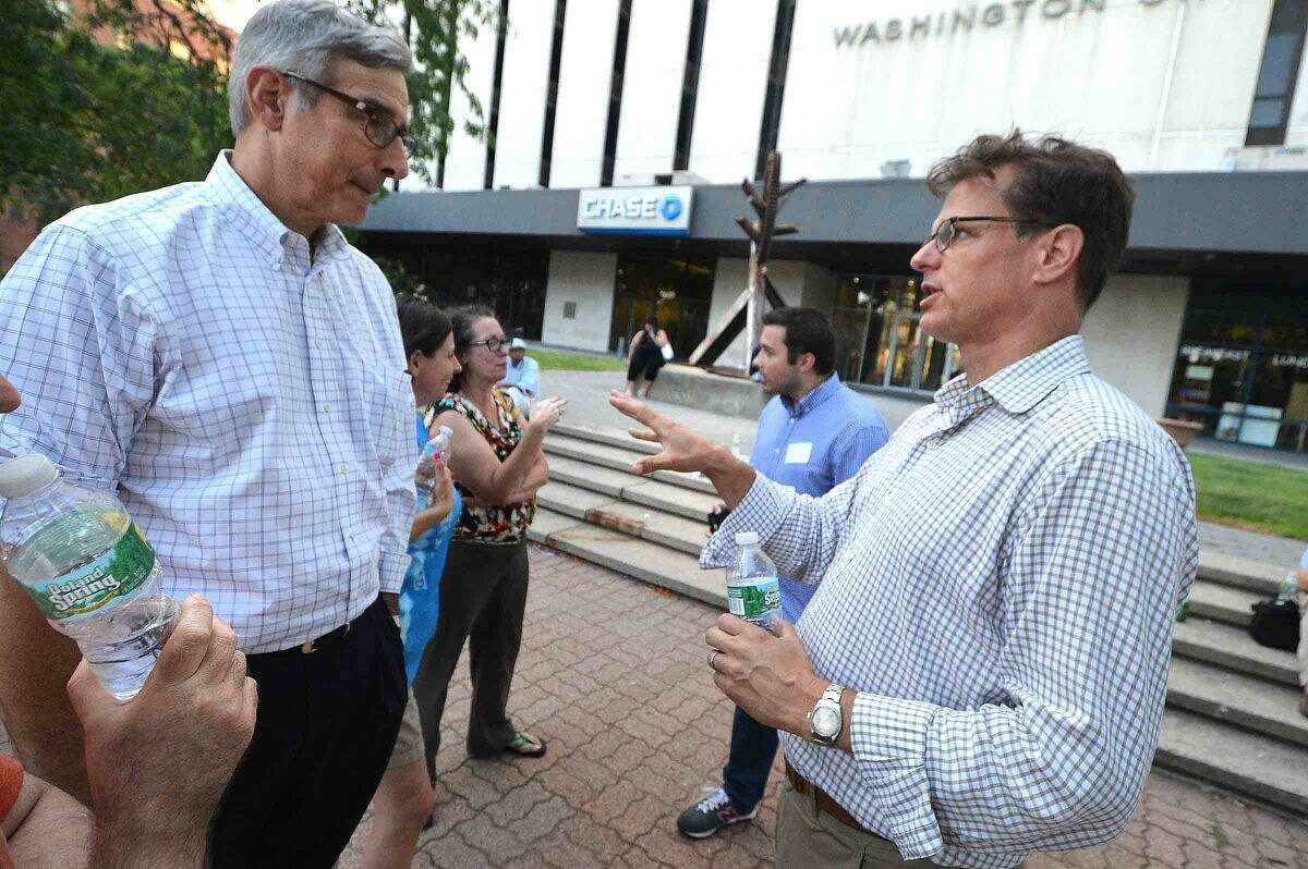 Hour Photo/Alex von Kleydorff GGP General Director Douglas T Adams talks with residents like Rowaytons David Katz about the new mall and the traffic it might create, during Community Summer Mixer sponsored by GGP. The party was to let people know about the propsed mall for South Norwalk. Residents were treated to free hot dogs hamburgers and all the trimmings and were entertained by a DJ, face painting and a balloon artist in the plaza at 50 Washington st.