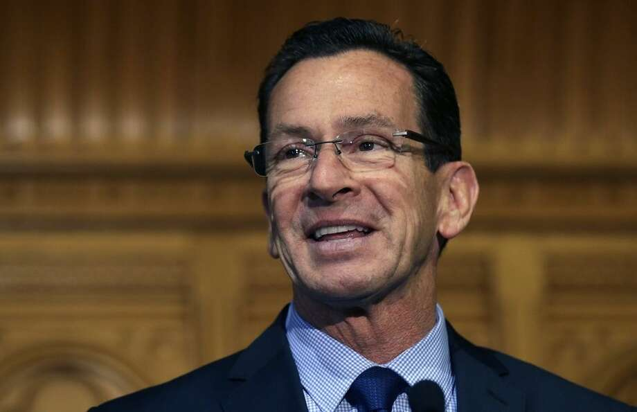 FILE - In this Nov. 5, 2014 file photo, Connecticut Gov. Dannel Malloy smiles as he thanks supporters at the State House in Hartford. As the legislature's budget-writing committees begin the task of crafting a response Malloy's proposed budget, one of the biggest challenges they face is replenishing deep cuts in social services/health funding (mostly Medicaid) while keeping under the state's constitutional cap on spending. (AP Photo/Charles Krupa)
