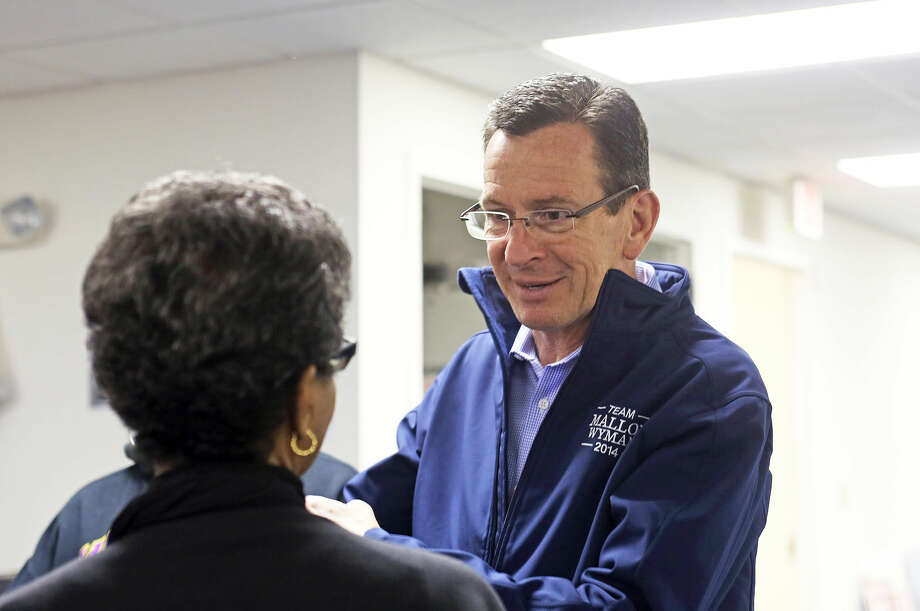 Governor Malloy speaks to an attendee during a stop Stamford Housing stop at 1250 Summer Street in Stamford Saturday, Nov. 1. Hour Photo / Danielle Calloway