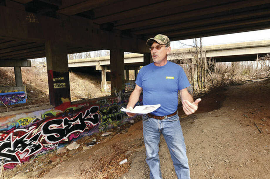 Hour photo / Erik TrautmannNorwalk Bike/Walk Task Force Co-Chairman Michael G. Mushak points out work area and plan to restore public access along the Norwalk River Wednesday and speaks on the newly allocated $350,000 that will be used to extend Norwalk River Valley Trail between Union Park and New Canaan Avenue.