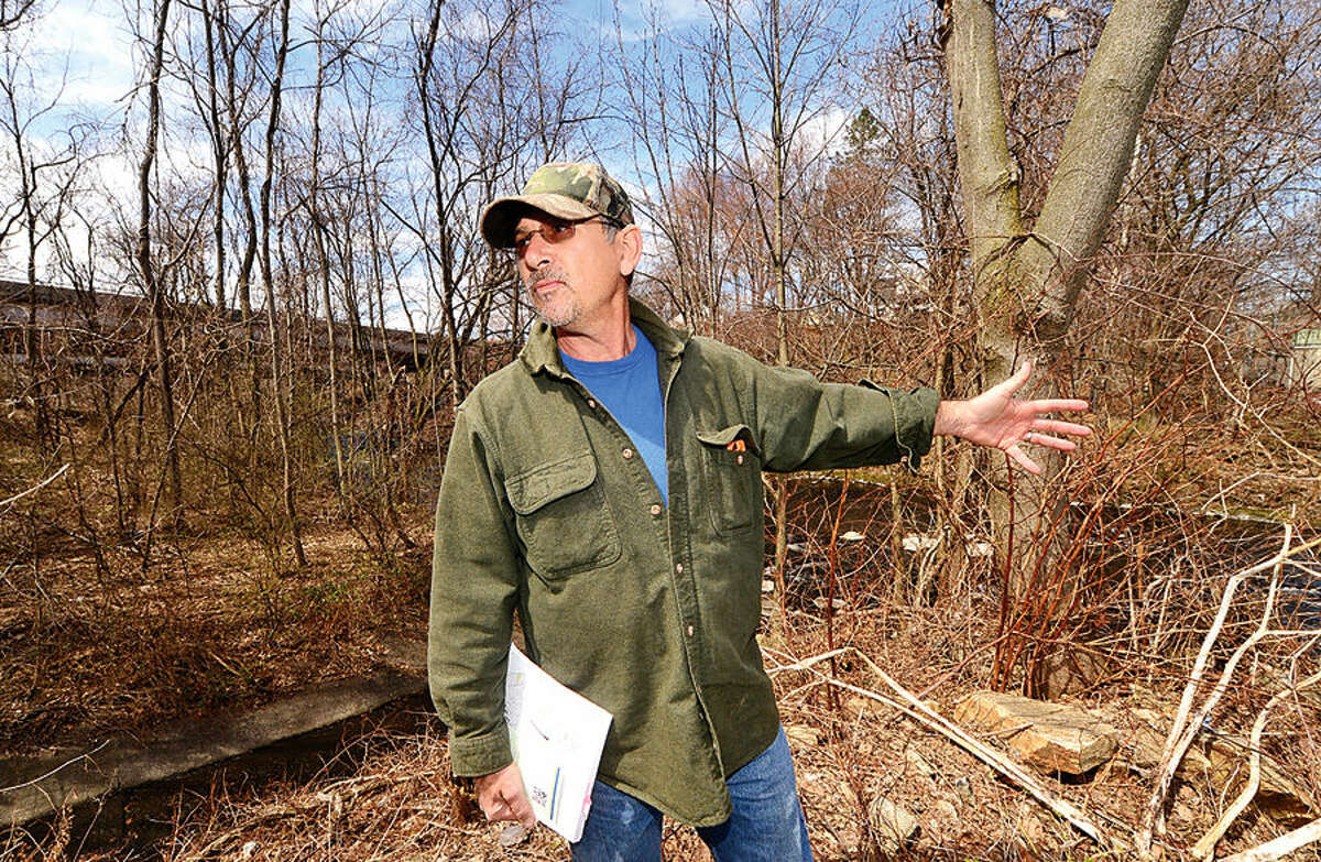 Hour photo / Erik Trautmann Norwalk Bike/Walk Task Force Co-Chairman Michael G. Mushak points out work area and plan to restore public access along the Norwalk River Wednesday and speaks on the newly allocated $350,000 that will be used to extend Norwalk River Valley Trail between Union Park and New Canaan Avenue.