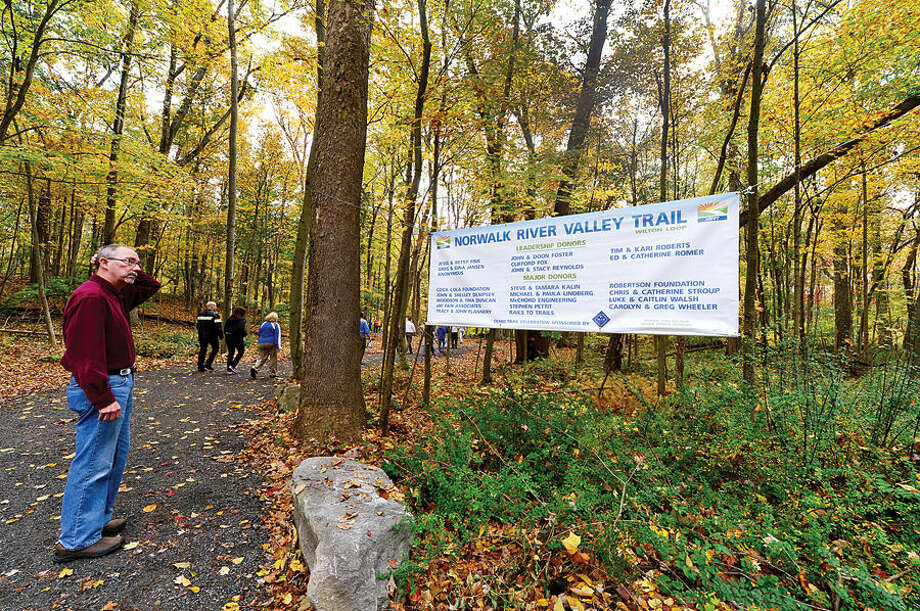 """Supporters of the Norwalk River Valley Trail (NRVT) hike a half-mile from Route 7 to attend the official announcement of the opening of a new section of the east-side """"Wilton Loop"""" Saturday."""
