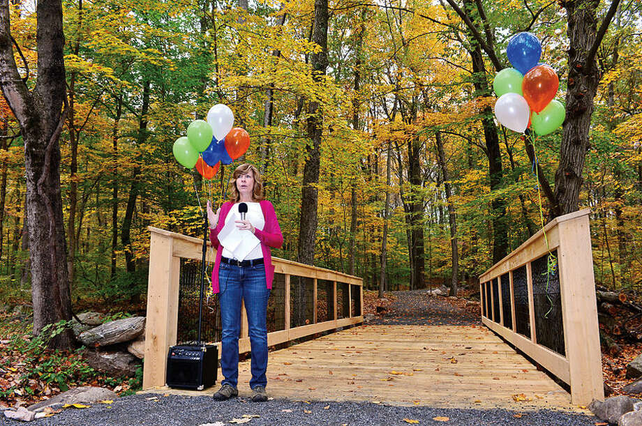 """Pat Sesto, chairman of the the Norwalk River Valley Trail (NRVT) project, speaks during the official opening of a new section of the east-side """"Wilton Loop"""" Saturday."""