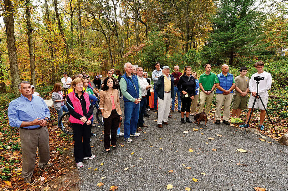 """Supporters of the Norwalk River Valley Trail (NRVT) hike the half-mile from Route 7 to attend the official announcement of the opening of a new section of the east-side """"Wilton Loop"""" Saturday."""