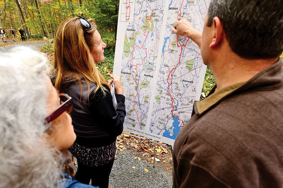 """Supporters of the Norwalk River Valley Trail (NRVT) hike a half-mile from Route 7 to attend the official announcement of the opening of a new section of the east-side """"Wilton Loop"""" on Saturday."""