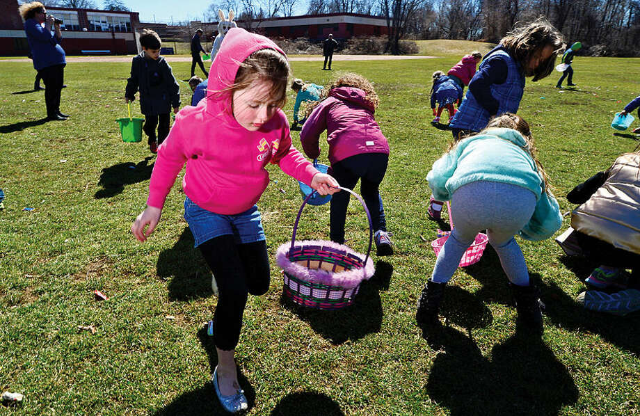 Hour photo / Erik Trautmann Gracie Masters and nearly two hundred children take part in the 64th annual Greens Farms Volunteer Fire Company Easter Egg Hunt at Long Lots School School Saturday