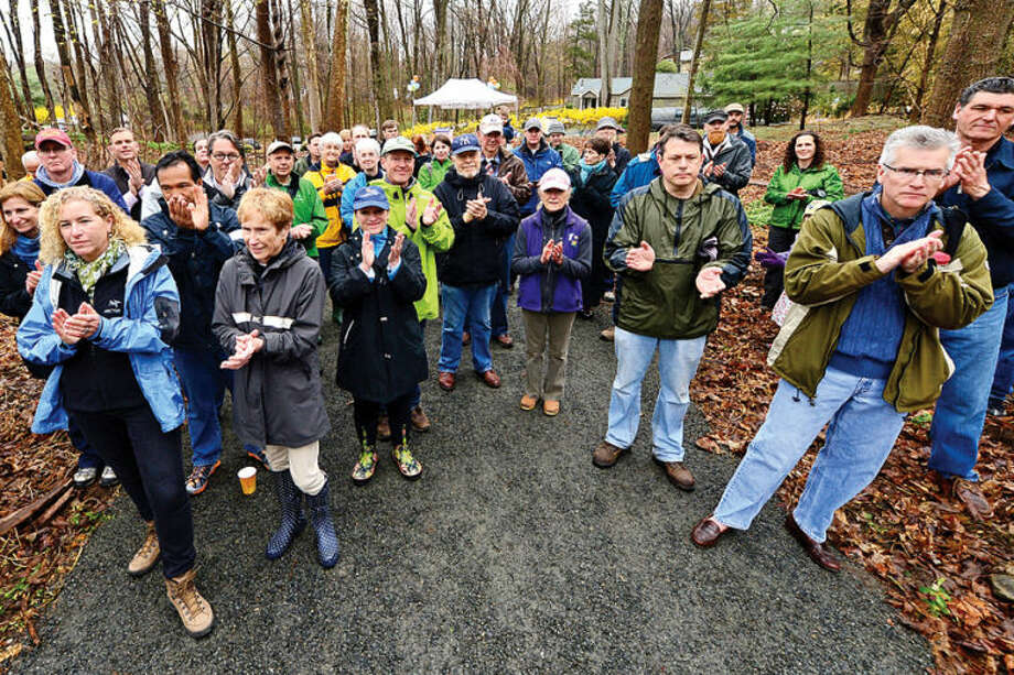 Hour photo / Erik Trautmann A corwd gathered despite the rain for The Norwalk River Valley Trail's Wilton Loop grand opening Saturday