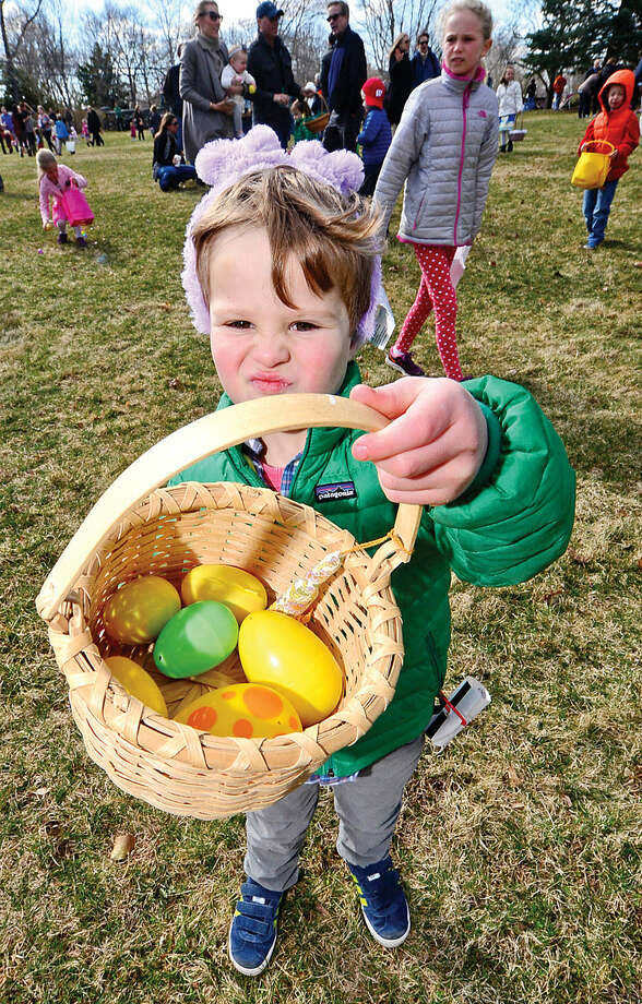 Hour photo / Erik Trautmann Henry Rader shows off his take following The Rowayton Community Association's annual Easter Egg Hunt Saturday at the Rowayton Community Center.
