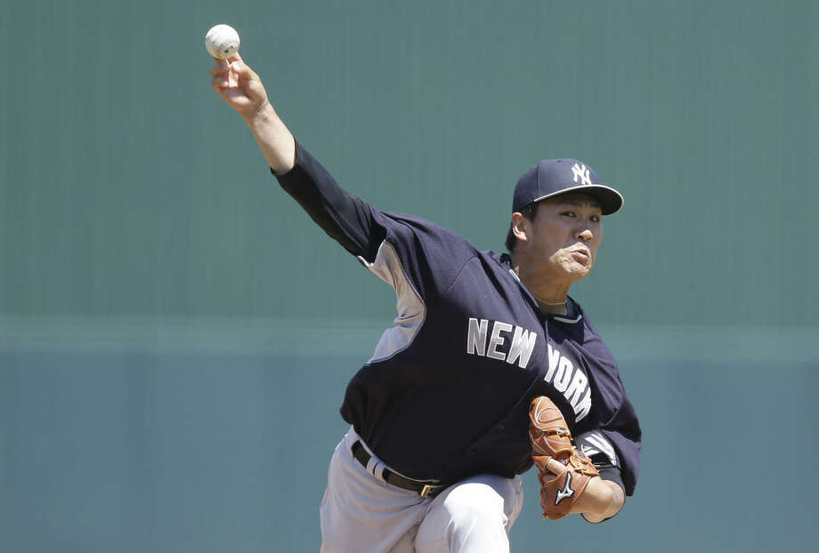 New York Yankees starting pitcher Masahiro Tanaka delivers against the Minnesota Twins in the first inning during an exhibition spring training baseball game, Tuesday, March 31, 2015, in Fort Myers, Fla. (AP Photo/Brynn Anderson)