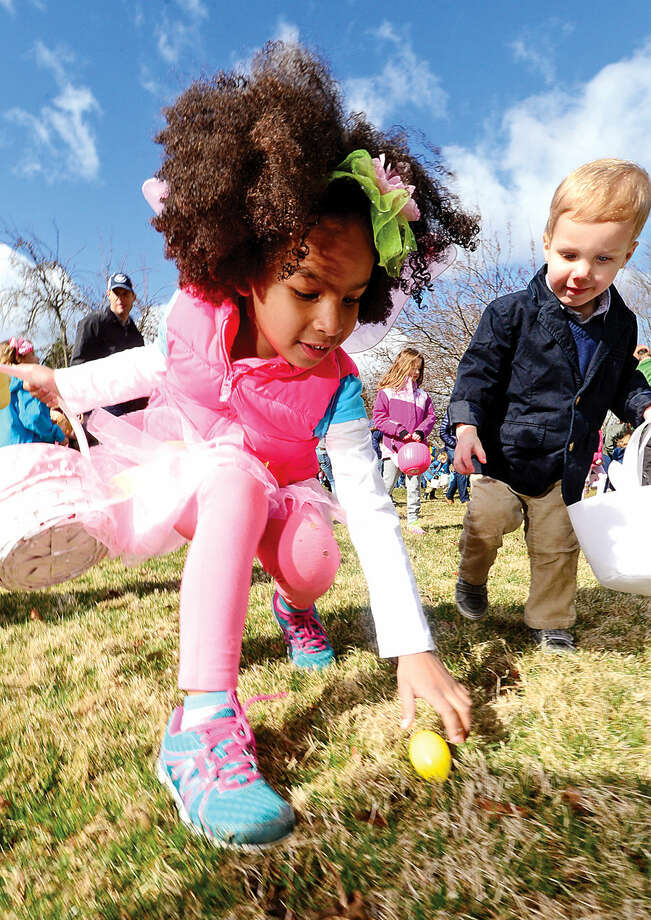 Hour photo / Erik Trautmann Keira Penn, 5, participates in The Rowayton Community Association's annual Easter Egg Hunt Saturday at the Rowayton Community Center.