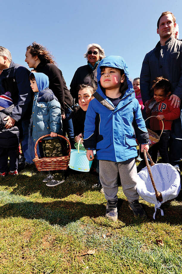 Hour photo / Erik Trautmann Nearly two hundred children take part in the 64th annual Greens Farms Volunteer Fire Company Easter Egg Hunt at Long Lots School School Saturday
