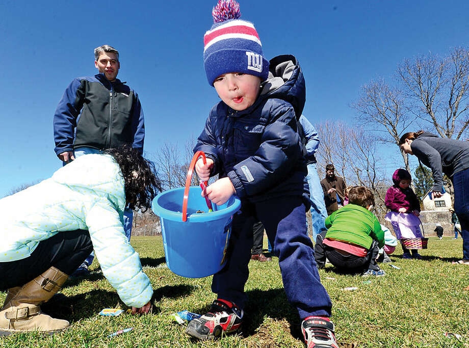 Hour photo / Erik Trautmann Ryan Vizzo, 2, and nearly two hundred children take part in the 64th annual Greens Farms Volunteer Fire Company Easter Egg Hunt at Long Lots School School Saturday