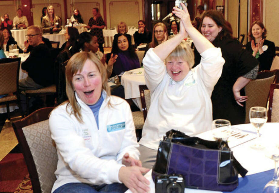 Laurie Bradbury and Daniela Sikra celebrate after being awarded over $1,250 for their fundraising efforts as 100 representatives of local nonprofits and community leaders celebrate the launch of Fairfield County Giving Day at the Norwalk Inn & Conference Center. Fairfield County Giving Day is an initiative to raise $1 million for up to 400 Fairfield County, nonprofits in 24-hours.