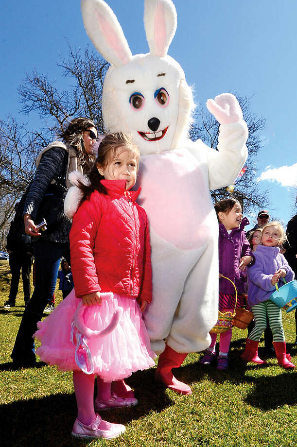 Hour photo / Erik Trautmann Chloe Bausenwein poses with the Easter Bunny as nearly two hundred children take part in the 64th annual Greens Farms Volunteer Fire Company Easter Egg Hunt at Long Lots School School Saturday
