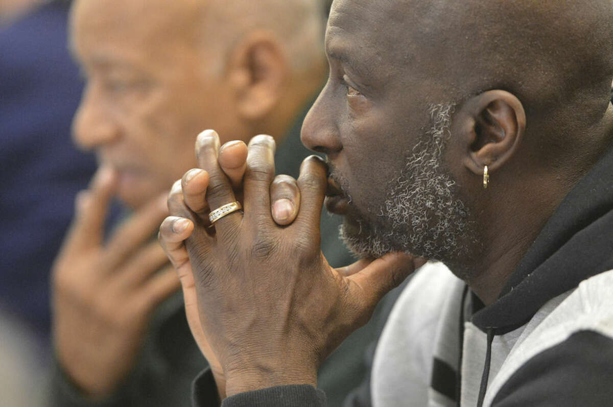 Hour Photo/Alex von Kleydorff Ray Smalls listens to the program speakers during the Community Breakfast in observance of Dr. Martin Luther King Jr. at West Rocks School