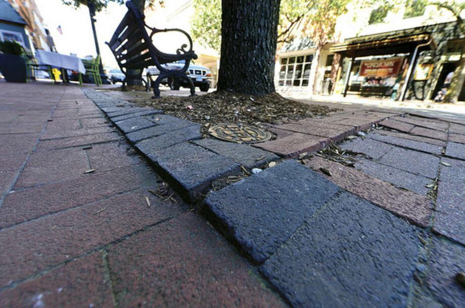 Hour photo / Erik Trautmann Norwalk DPW has plans road paving and tree replacement on Washington St next year.