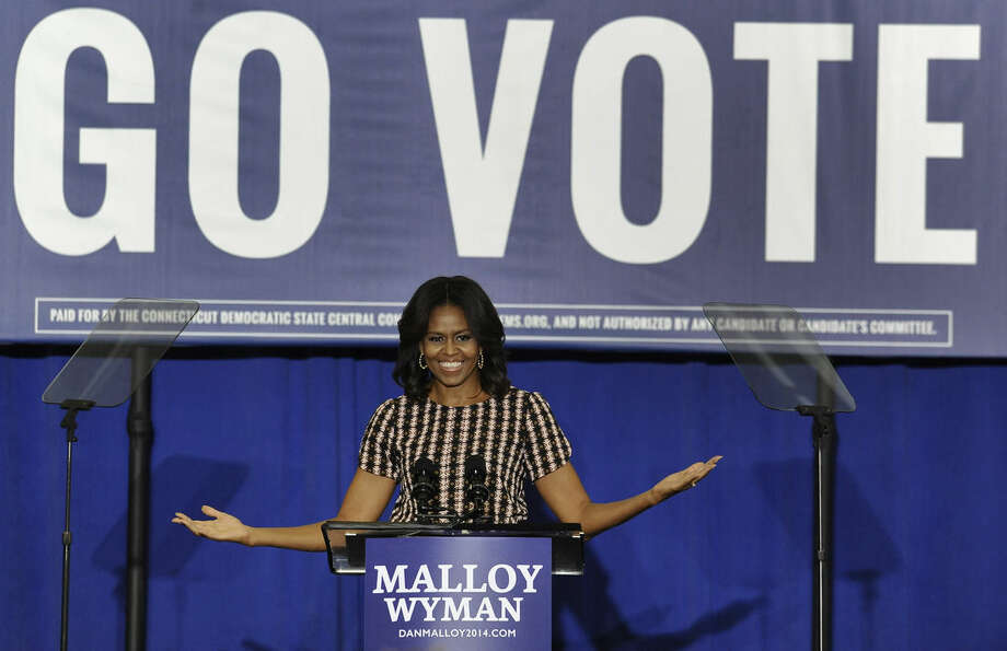 First lady Michelle Obama gestures as she speaks to supporters during a rally for Connecticut Gov. Dannel P. Malloy Thursday, Oct. 30, 2014, in New Haven, Conn. (AP Photo/Jessica Hill)