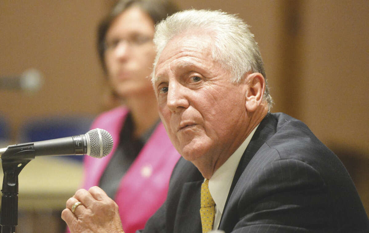 Hour photo/Alex von Kleydorff In this file photo, Mayor Harry Rilling and mayoral candidate Kelly Straniti answer questions during a League of Women Voters Mayoral forum at City Hall Wednesday evening.