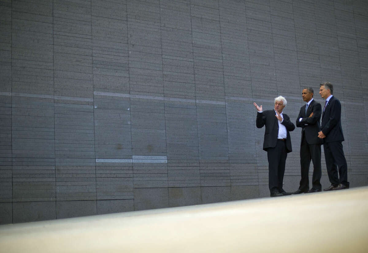 President Barack Obama and Argentine President Mauricio Macri, right, listen to Marcleo Brodsky at Parque de la Memoria (Remembrance Park) in Buenos Aires, Argentina, Thursday, March 24, 2016. Obama visited the memorial to victims of the country's murderous US-backed dictatorship who were killed or went missing from 1976-1983. Brodsky's brother Fernando Brodsky is one of the people who disappeared. (AP Photo/Pablo Martinez Monsivais)