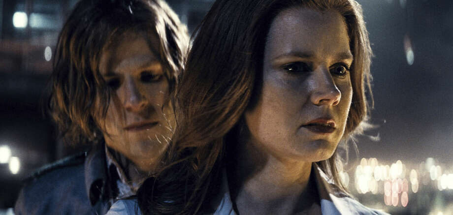 "This image released by Warner Bros. Pictures shows Jesse Eisenberg, left, and Amy Adams in a scene from, ""Batman v Superman: Dawn of Justice."" (Warner Bros. Pictures via AP)"