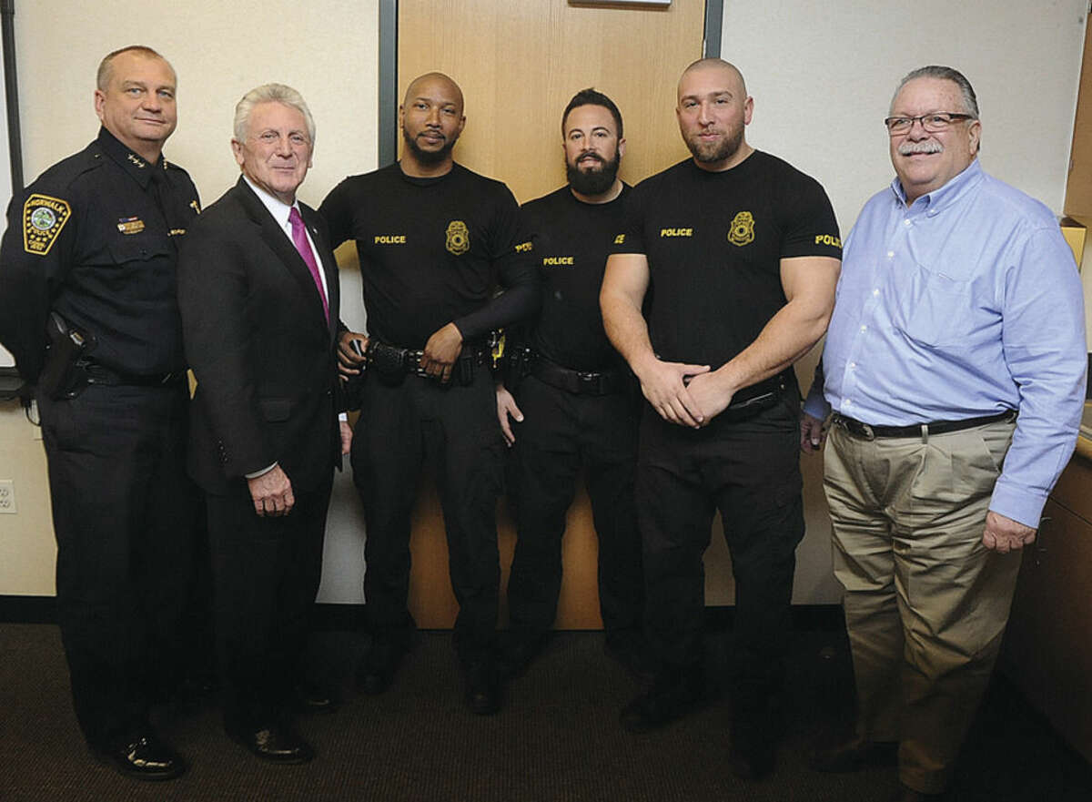 Officers of the month at the Norwalk Police Headquarters, from left Norwalk Police Chief Thomas E. Kulhawik, Norwalk Mayor Harry Rilling, officers of the month, Owen Lee, David Geismar, Michael Pugliese and police commision member Charles Yost. Hour photo/Matthew Vinci