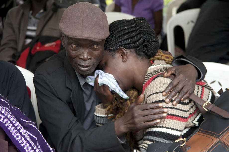 A relative consoles a woman after she viewed the body of her relative killed in Thursday's attack on Garissa University College, at Chiromo funeral home in Nairobi, Kenya, Monday, April 6, 2015. Al-Shabab gunmen rampaged through the university in northeastern Kenya at dawn Thursday, killing scores of people in the group's deadliest attack in the East African country. Four militants were slain by security forces to end the siege just after dusk. (AP Photo/Sayyid Azim)