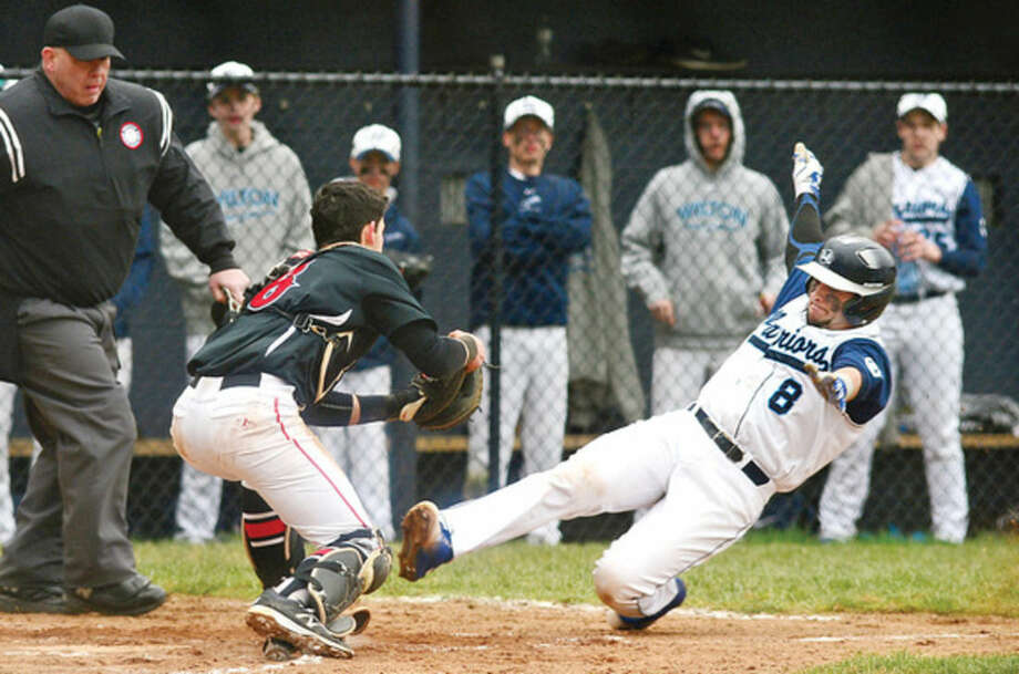 Hour photo/ Erik TrautmannWilton High School baseball player Brennen Ryan (8) slides into home during their game against Cheshire Saturday, in Wilton.