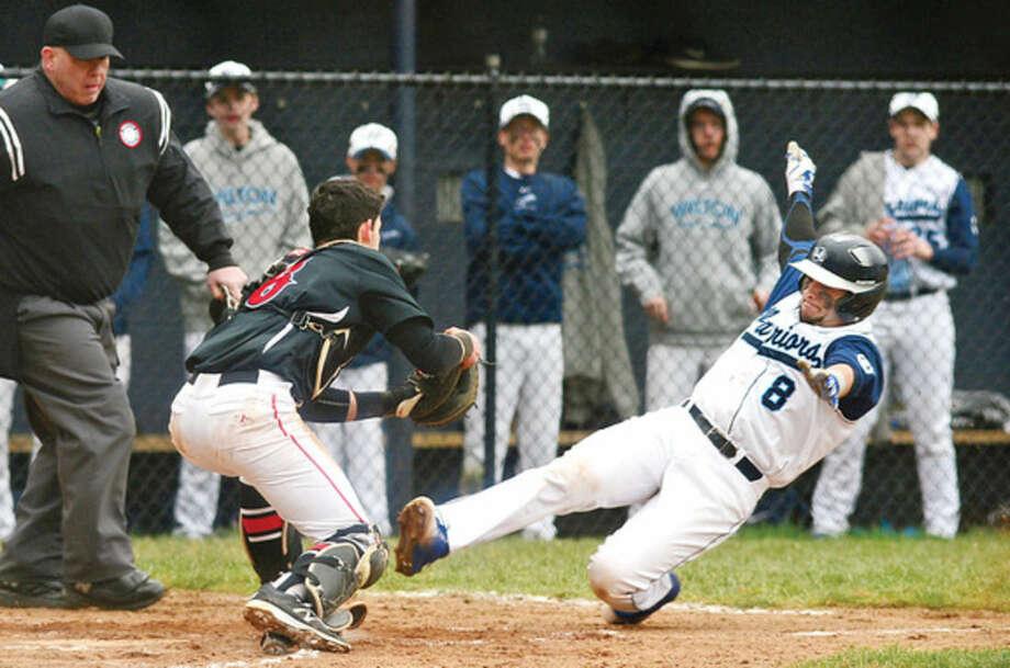 Hour photo/ Erik TrautmannWilton High School baseball player Brennen Ryan (8) slides into home during their game against Cheshire Saturday, in Wilton.