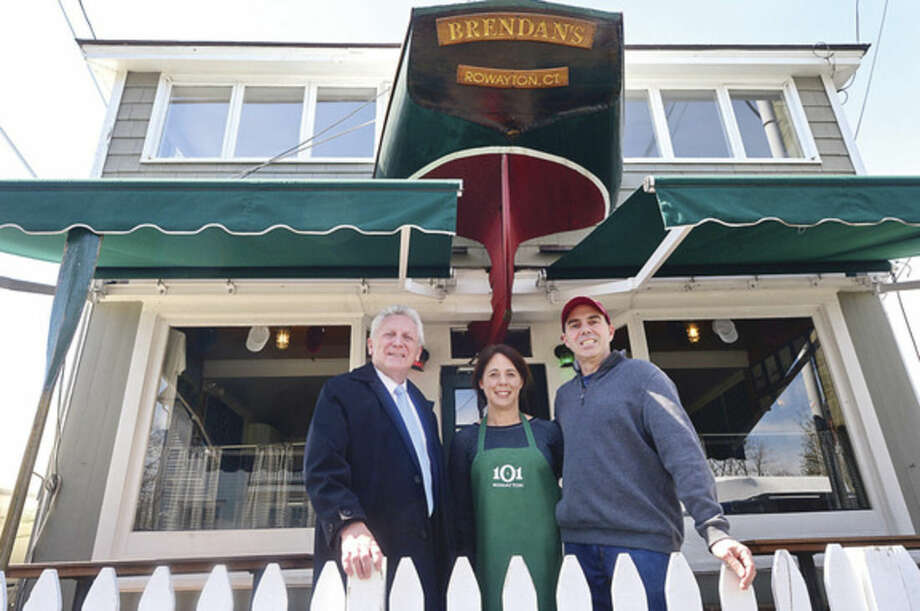 Hour photo / Erik Trautmann Norwalk Mayor Harry Rilling, left, visits with the owners of Brendan's 101 in Rowayton, Christine and Brendan McGee, as part of the mayor's small business intiative Wednesday.