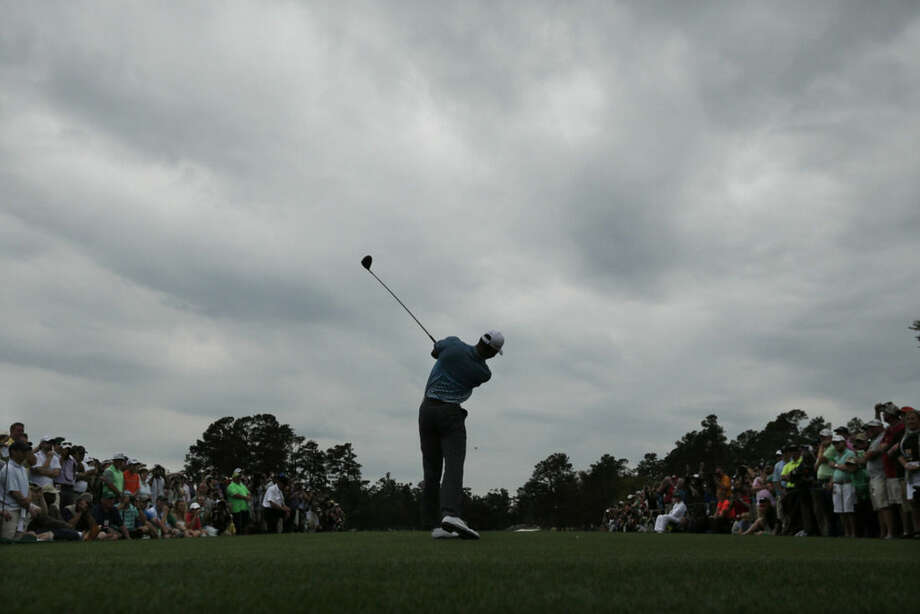 Tiger Woods tees off on the first hole during a practice round for the Masters golf tournament Monday, April 6, 2015, in Augusta, Ga. (AP Photo/Charlie Riedel)