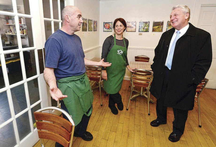 Hour photo / Erik TrautmannNorwalk Mayor Harry Rilling, right, visits with the owners of Brendan's 101 in Rowayton, Brendan and Christine McGee, as part of the mayor's small business intiative Wednesday.
