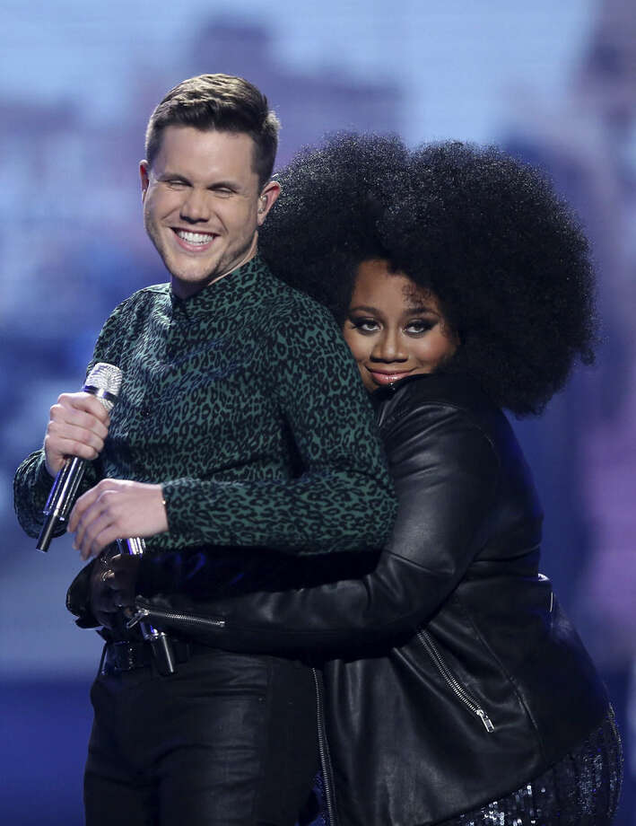 """Trent Harmon, left, and La'Porsha Renae appear at the """"American Idol"""" farewell season finale at the Dolby Theatre on Thursday, April 7, 2016, in Los Angeles. (Photo by Matt Sayles/Invision/AP)"""