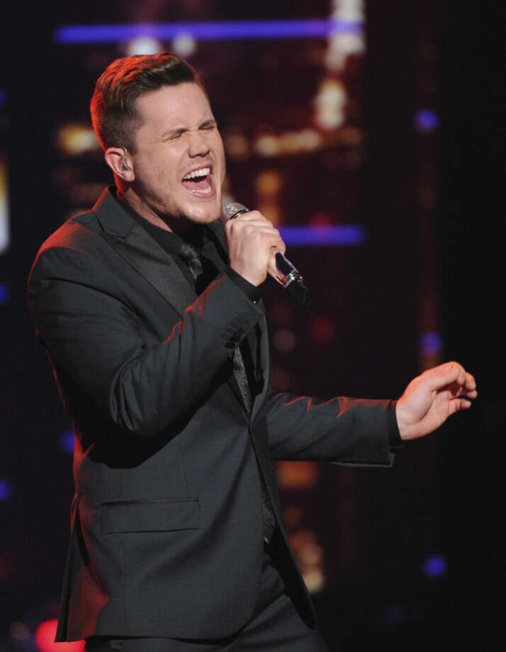 "In this April 6, 2016 photo released by Fox, Trent Harmon performs on the singing competition series, ""American Idol,"" in Los Angeles. The winner of the final seaon will be chosen on Thursday. (Michael Becker/FOX via AP)"