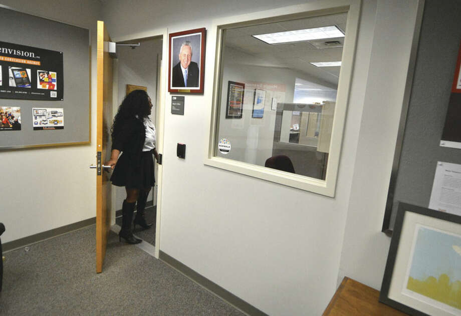 Hour Photo/Alex von Kleydorff Sally Johnson, The Mayors Executive Assistant enters the Mayors office where security upgrades will include controlled access trough the door and a security window as well.