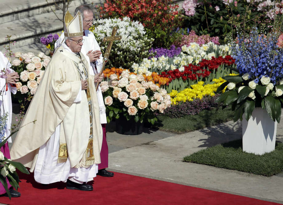 Pope Francis walks with his pastoral staff as he celebrates the Easter mass, in St. Peter's Square, at the Vatican, Sunday, March 27, 2016. (AP Photo/Gregorio Borgia)