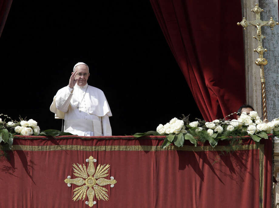 Pope Francis delivers the Urbi et Orbi (to the city and to the world) message at end of the Easter mass, in St. Peter's Square, at the Vatican, Sunday, March 27, 2016. (AP Photo/Gregorio Borgia)