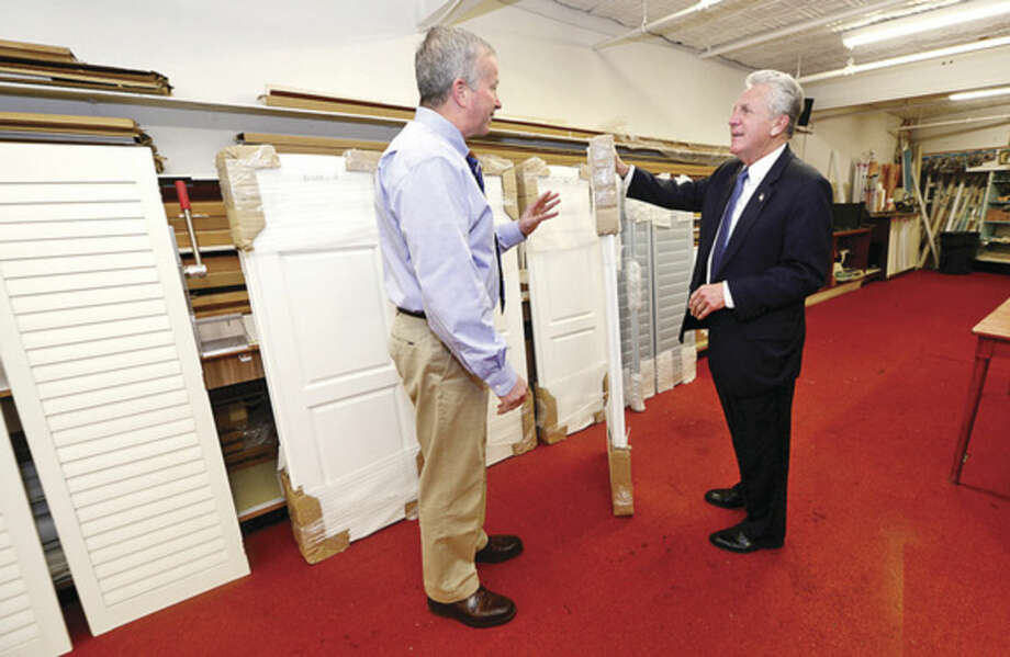 Hour photo/Erik TrautmannNorwalk Mayor Harry Rilling, right, visits with Fullam's Window Treatments owner Peter Fullam Wednesday as part of the mayor's small business spotlight initiative.