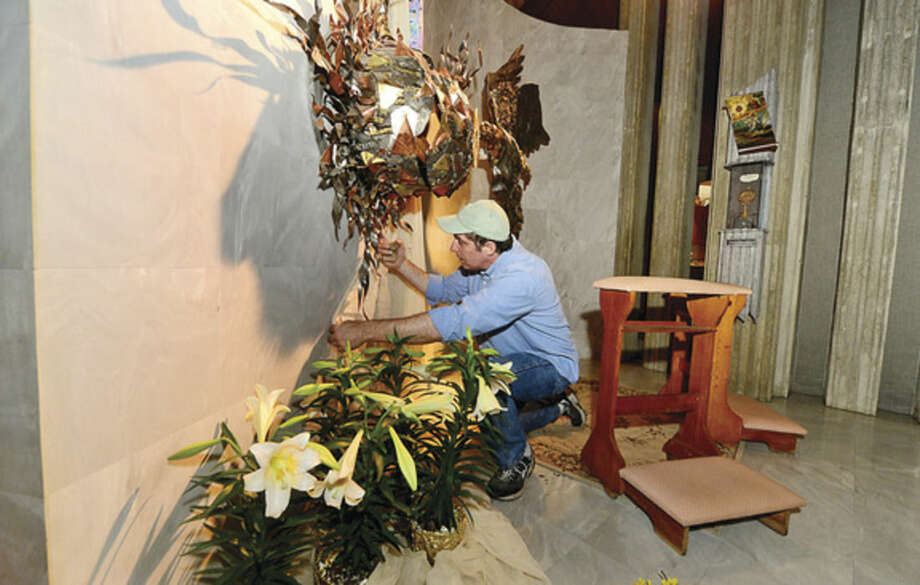 Hour photo / Erik Trautmann Members of the St. Philip Artist Guild including co-chair Ralph DiMarco decorate the St. Philp Church for Easter. The Guild provides original art for each liturgical season at the church.
