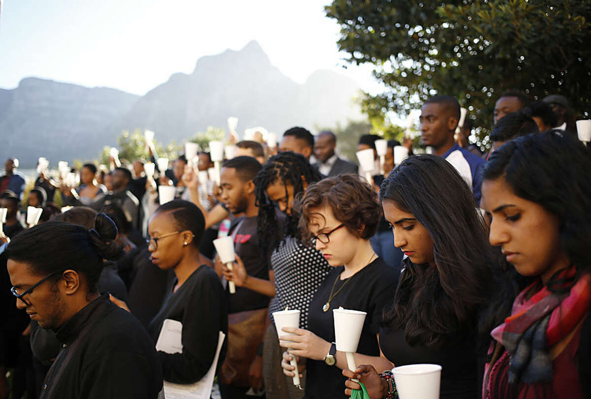 Students attends a vigil for people killed in an attack on a college by Islamic militants in Garissa, Kenya, at the University of Cape Town, in Cape Town, South Africa, Monday, April 6, 2015. Kenya launched airstrikes against Islamic militants in Somalia following an extremist attack on a Kenyan college that killed 148 people, a military spokesman said Monday. (AP Photo/Schalk van Zuydam)
