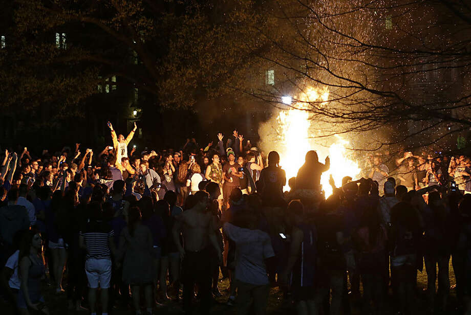 Duke students and fans celebrate around a bonfire on campus in Durham, N.C., following Duke's win over Wisconsin in the NCAA Final Four college basketball tournament championship game Monday, April 6, 2015. (AP Photo/Gerry Broome)