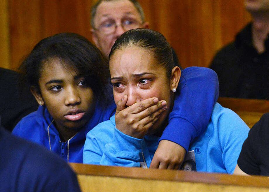 Genesis Ricon's sister Alexis Rincon, left, and her mother Jenny Calderon react as defendants Jeffrey Ellerbee and Jhymiere Moore are arraigned Monday, April 6, 2015, in Patterson N.J. Both men pleaded not guilty to murder and weapons charges stemming from the death of Genesis Ricon, a 12-year-old girl who was struck by a stray bullet last summer while riding a scooter in northern New Jersey. (AP Photo/Northjersey.com, Amy Newman, Pool)