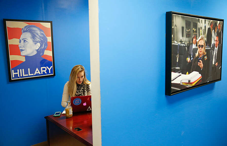In this April 3, 2015, photo, intern Jessica Lis works at the Ready for Hillary super PAC offices in Arlington, Va. When Hillary Rodham Clinton announces her presidential campaign, as expected, more than a dozen people in a nondescript office building overlooking the Potomac River will blast out the news by email and social media to millions of her supporters, urging them to sign onto her campaign. And then the super PAC will begin winding down its operations just as the Democrat opens her White House campaign. (AP Photo/Andrew Harnik)