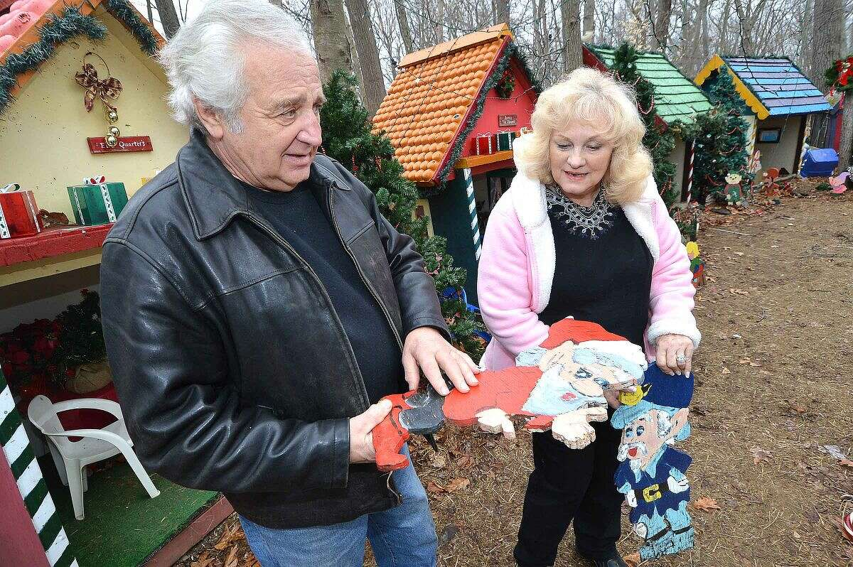 Hour Photo/Alex von Kleydorff Rick and Joan Setti will hold a tag sale to sell the items they have built and displayed over the last 26 Holiday's at their Norwalk home. Here they look over two of the first characters they hand made that have stood the test of time over the years